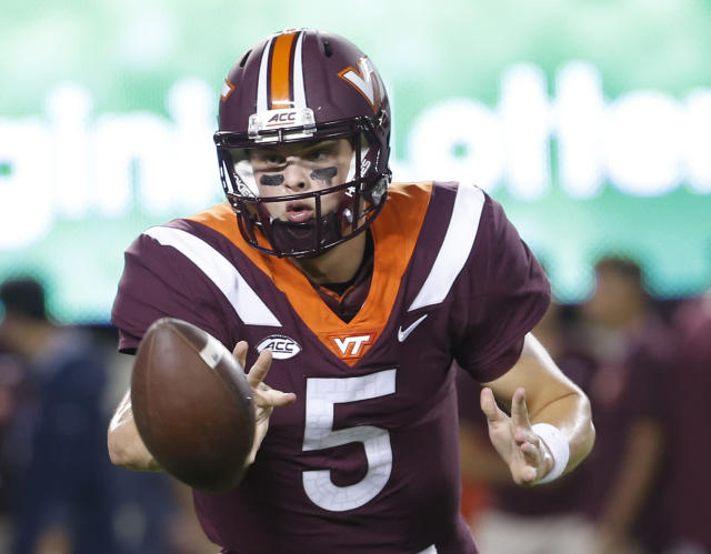 FILE - In this Oct. 6. 2018, file photo, Virginia Tech quarterback Ryan Willis (5) warms up prior to the start of an NCAA college football game in Blacksburg, Va. (AP Photo/Steve Helber, File)