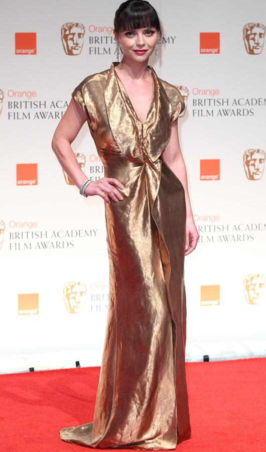 Celebrity fashion gold dresses: Christina Ricci took to a plunging neckline at the  BAFTAs while the rest of dress followed a gold leaf look.