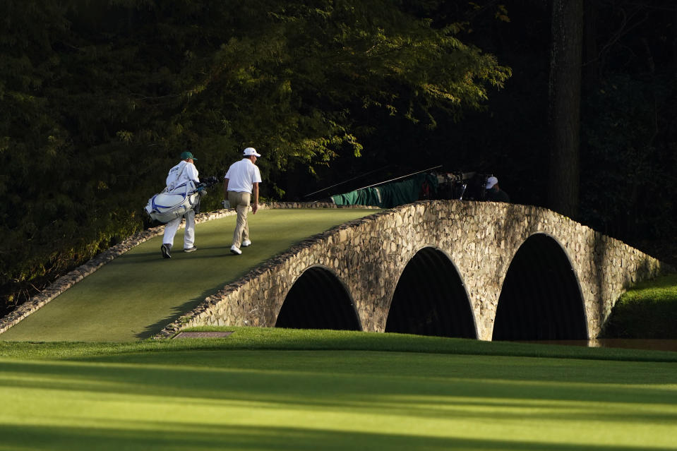 Jose Maria Olazabal, of Spain, walks over the bridge on the 13th green during the first round of the Masters golf tournament Thursday, Nov. 12, 2020, in Augusta, Ga. (AP Photo/Chris Carlson)