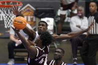 Mississippi State guard Cameron Matthews (4) goes up for a shot as Memphis center Moussa Cisse, rear, defends in the second half of an NCAA college basketball championship game in the NIT, Sunday, March 28, 2021, in Frisco, Texas. (AP Photo/Tony Gutierrez)