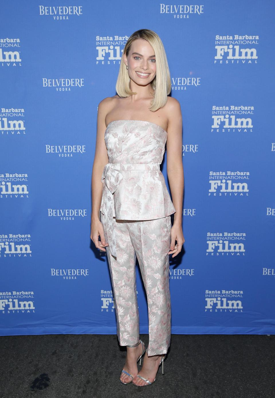 <p>The film star wore a brocade print Prada, finished with silver strappy sandals. <em>[Photo: Getty] </em> </p>