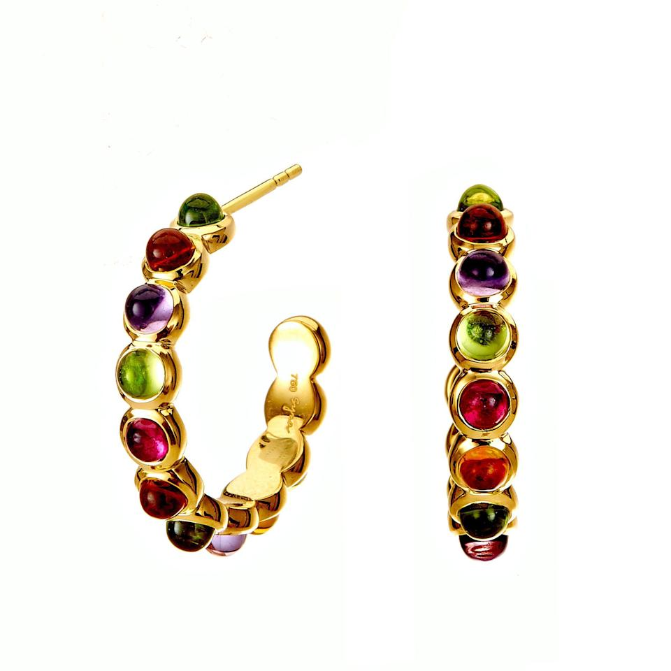 """<p><strong>Syna Jewels </strong></p><p>synajewels.com</p><p><strong>$2950.00</strong></p><p><a href=""""https://synajewels.com/collections/earrings/products/candy-multicolor-hoop-earrings"""" rel=""""nofollow noopener"""" target=""""_blank"""" data-ylk=""""slk:Shop Now"""" class=""""link rapid-noclick-resp"""">Shop Now</a></p><p>Dharmesh and Namrata Kothari have created an extraordinary and refreshing collection of luxurious jewels that is deeply rooted in sustainability. Their pieces are made to order and feature meticulously selected, ethically sourced stones and metals.</p>"""