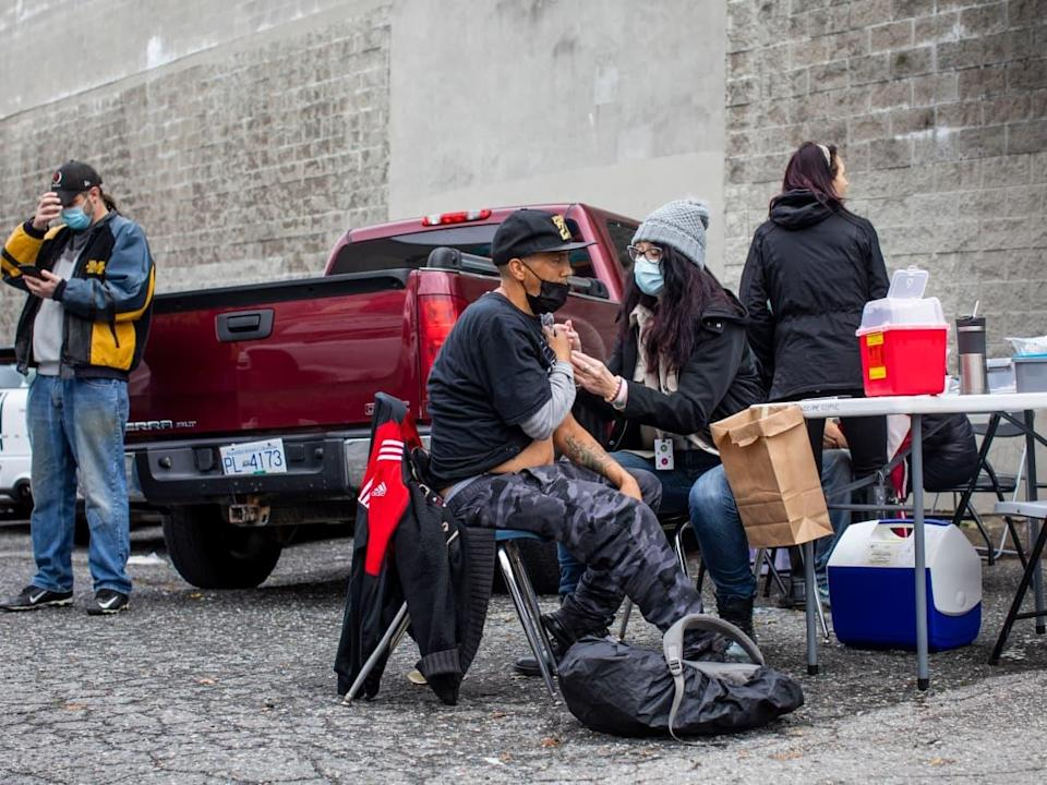 A COVID-19 vaccination clinic is pictured in the Downtown Eastside neighbourhood of Vancouver, British Columbia on Wednesday, Oct. 13, 2021.  (Ben Nelms/CBC - image credit)