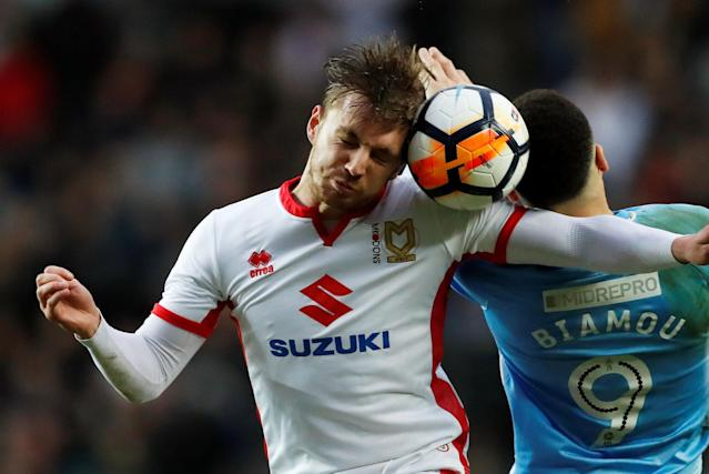 Soccer Football - FA Cup Fourth Round - Milton Keynes Dons vs Coventry City - Stadium MK, Milton Keynes, Britain - January 27, 2018 MK Dons' Alex Gilbey in action with Coventry's Maxime Biamou Action Images/Andrew Boyers