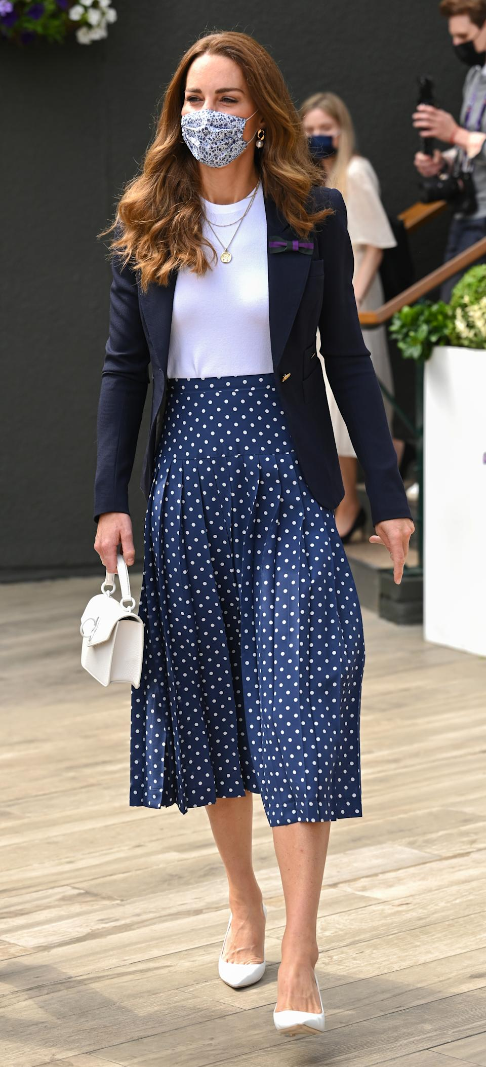 The Duchess of Cambridge attends Wimbledon Championships Tennis Tournament at All England Lawn Tennis and Croquet Club on July 2, 2021, in London,  wearing an Alessandra Rich skirt.  (Getty Images)