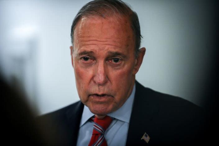 White House National Economic Council Director Larry Kudlow talks with media during a break in a meeting to wrap up work on coronavirus economic aid legislation