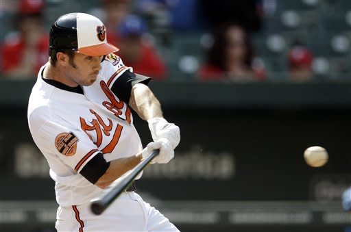 Baltimore Orioles' J.J. Hardy hits a solo home run in the first inning of the first baseball game of a doubleheader against the Texas Rangers in Baltimore, Thursday, May 10, 2012. (AP Photo/Patrick Semansky)