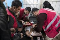 Syrian medics treat a baby at a camp clinic in Al-Hol but dozens have had to be rushed to hospital in the city of Hasakeh an hour away for emergency treatment for severe acute malnutrition