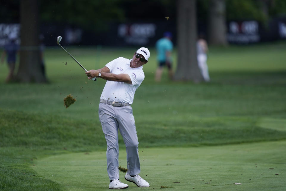 Phil Mickelson hits onto the 13th green during the second round of the Rocket Mortgage Classic golf tournament, Friday, July 2, 2021, at the Detroit Golf Club in Detroit. (AP Photo/Carlos Osorio)
