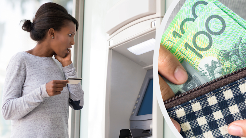 Pictured: Shocked woman at ATM machine, hand going into purse with Australian $100 notes. Images: Getty