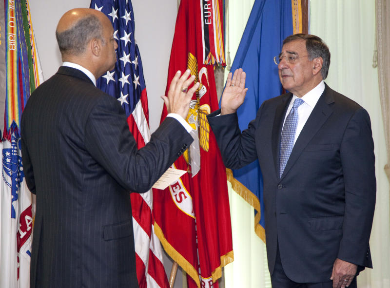 Leon Panetta, right, is sworn is as Defense Secretary by Pentagon General Counsel Jeh Johnson, Friday, July 1, 2011, at the Pentagon.  (AP Photo/Evan Vucci)