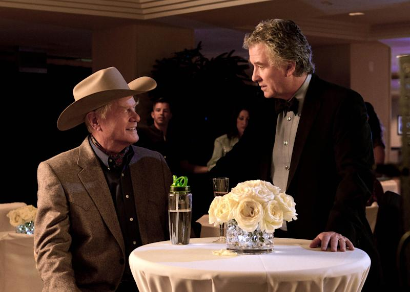 """This publicity image released by TNT shows Larry Hagman as J.R. Ewing, left, and Patrick Duffy as Bobby Ewing in a scene from """"Dallas,"""" on TNT.  TNT begins the second season of its """"Dallas"""" revival next month. The network said Tuesday, Dec. 11, that it will hold a funeral for Larry Hagman's memorable character at some point in the 15-episode season but that it hasn't been filmed or scheduled yet. Hagman died at age 81 over the Thanksgiving weekend. (AP Photo/TNT, Zade Rosenthal)"""