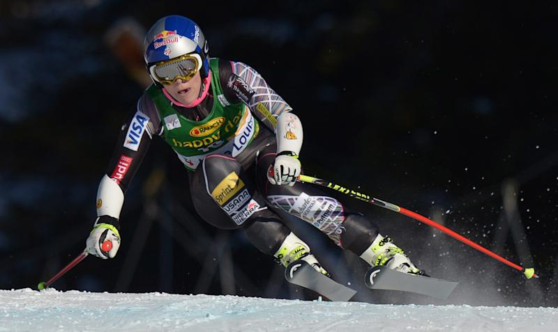 Lindsey Vonn races during the women's World Cup super-G skiing event at Lake Louise, Alberta, Sunday, Dec. 8, 2013. (AP Photo/The Canadian Press, Jonathan Hayward)