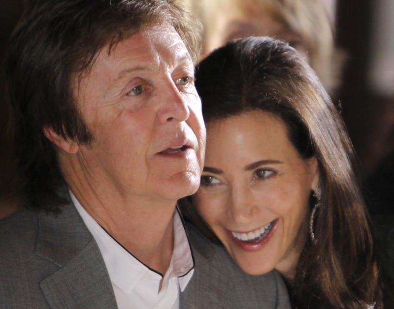 FILE -  This is a Monday, Oct. 4, 2010 file photo of British musician Paul McCartney and his girlfriend Nancy Shevell as they watch Stella McCartney's spring-summer 2011 ready to wear fashion collection show in Paris. Paul McCartney is set to tie the knot at the venue where he first married more than 40 years ago. Officials said Friday Sept. 16, 2011 that the former Beatle and fiancee Nancy Shevell have posted a notice of intention to marry at London's Marylebone Register Office. (AP Photo/Thibault Camus)