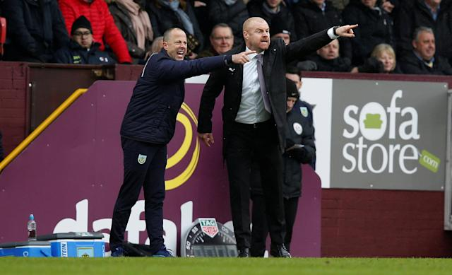 "Soccer Football - Premier League - Burnley vs Manchester City - Turf Moor, Burnley, Britain - February 3, 2018 Burnley manager Sean Dyche and assistant manager Ian Woan gesture REUTERS/Andrew Yates EDITORIAL USE ONLY. No use with unauthorized audio, video, data, fixture lists, club/league logos or ""live"" services. Online in-match use limited to 75 images, no video emulation. No use in betting, games or single club/league/player publications. Please contact your account representative for further details."
