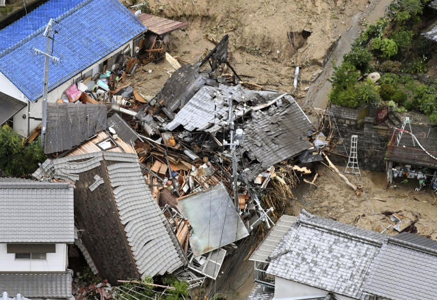 <p>Residential buildings are damaged by a landslide caused by heavy rains in Sakacho, Hiroshima prefecture, south western Japan, Saturday, July 7, 2018. (Photo: Kyodo News via AP) </p>