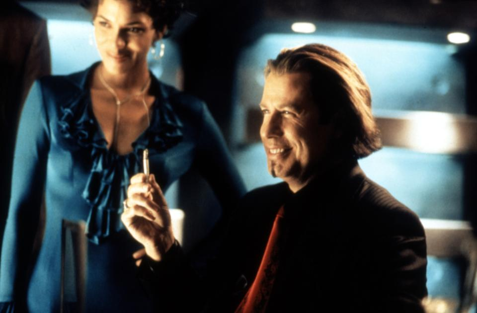 Berry and Travolta in the 2001 action movie, 'Swordfish' (Photo: Warner Brothers/courtesy Everett Collection)