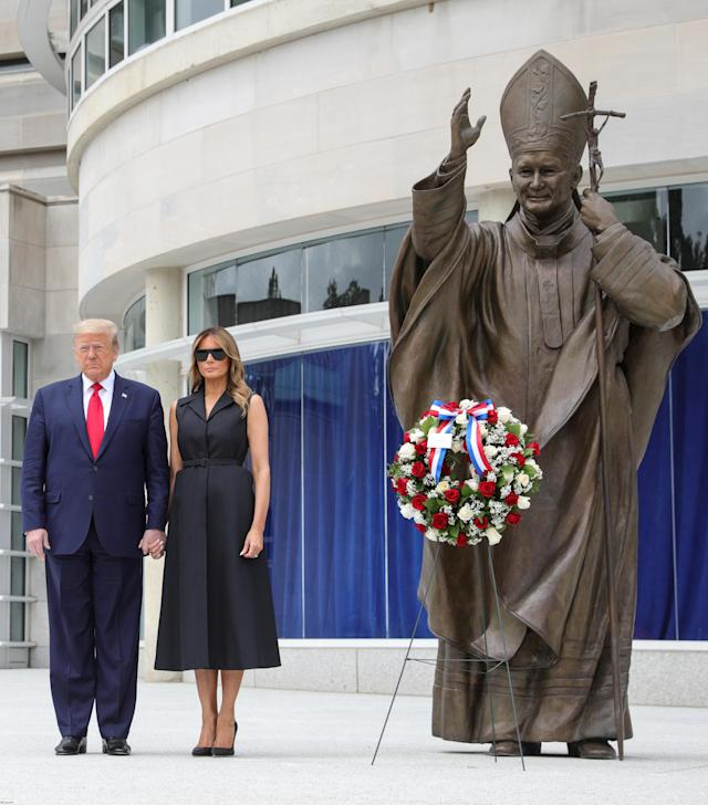 President Trump and Melania Trump at the Saint John Paul II National Shrine in Washington on Tuesday. (Tom Brenner/Reuters)