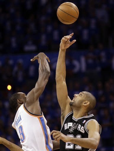 Oklahoma City Thunder power forward Serge Ibaka (9), from the Republic of Congo, and San Antonio Spurs center Tim Duncan (21) compete for the tip-off at the beginning of Game 3 in their NBA basketball Western Conference finals playoff series, Thursday, May 31, 2012, in Oklahoma City. (AP Photo/Sue Ogrocki)