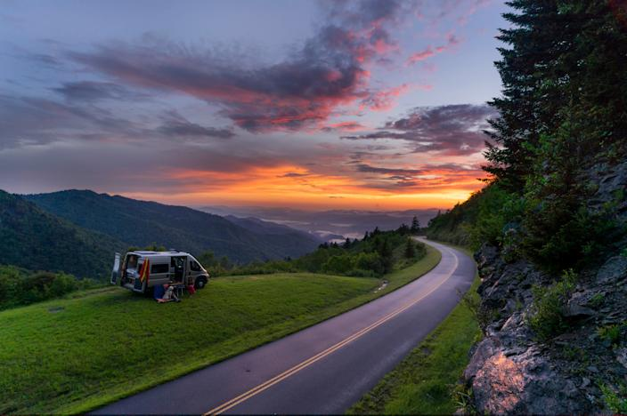 "<div class=""caption""> The Blue Ridge Parkway near Waterrock Knob at sunset. North Carolina has become a road tripper's dream thanks to the state's smart COVID-19 travel initiatives. </div> <cite class=""credit"">Photo: Courtesy of VisitNC.com / Steve Yocom</cite>"