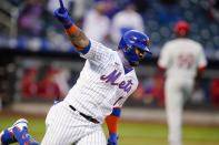 New York Mets' Jonathan Villar celebrates after hitting a single to drive in the winning run during the eighth inning against the Philadelphia Phillies in the first game of a baseball doubleheader Tuesday, April 13, 2021, in New York. The Mets won 4-3. (AP Photo/Frank Franklin II)