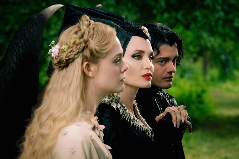 Elle Fanning is Aurora, Angelina Jolie is Maleficent and Sam Riley is Diaval. (Disney)