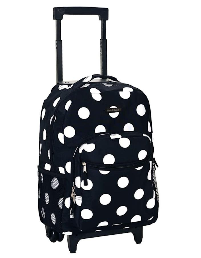 """Find this <a href=""""https://amzn.to/3g4N6g9"""" rel=""""nofollow noopener"""" target=""""_blank"""" data-ylk=""""slk:Rockland rolling backpack"""" class=""""link rapid-noclick-resp"""">Rockland rolling backpack</a> for $28 on <a href=""""https://amzn.to/3g4N6g9"""" rel=""""nofollow noopener"""" target=""""_blank"""" data-ylk=""""slk:Amazon"""" class=""""link rapid-noclick-resp"""">Amazon</a>."""