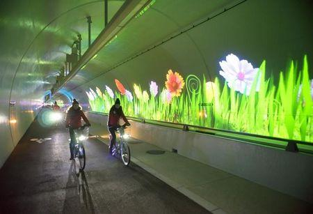 People visit the 2nd Croix Rousse tunnel reserved for pedestrians, bicycles and buses during its inauguration ceremony in Lyon