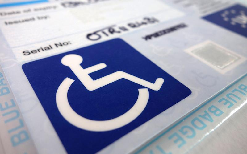 A disability blue badge -  Kevin Britland / Alamy Stock Photo/https://www.alamy.com