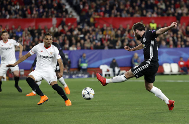 Manchester United's Juan Mata, right, attempts a shot at goal during the Champions League round of sixteen first leg soccer match between Sevilla FC and Manchester United at the Ramon Sanchez Pizjuan stadium in Seville, Spain, Wednesday, Feb. 21, 2018. (AP Photo/Miguel Morenatti)