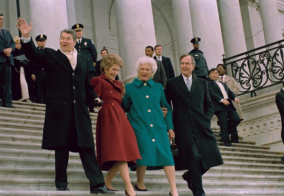 Former President Ronald Reagan, his wife, Nancy, new first lady Barbara Bush and President George H.W. Bush walk down the Capitol steps after the inaugural ceremony, Jan. 20, 1989. (Photo: J. Scott Applewhite/AP)