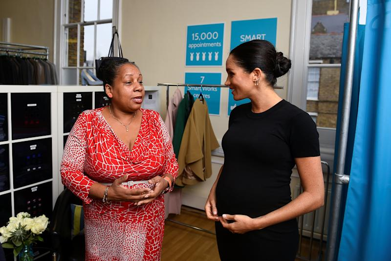 Britain's Meghan, the Duchess of Sussex, chats with Patsy Wardally as they pick out clothes, during her visit to Smart Works, a charity to which she has become patron, at St Charles hospital in west London on January 10, 2019. (Photo by CLODAGH KILCOYNE / POOL / AFP) (Photo credit should read CLODAGH KILCOYNE/AFP via Getty Images)