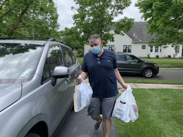 Dailey is pictured delivering groceries (Photo courtesy of Greg Dailey)