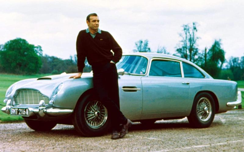 Sean Connery, who played James Bond, standing with the Aston Martin DB5 used in Goldfinger - Rex Features