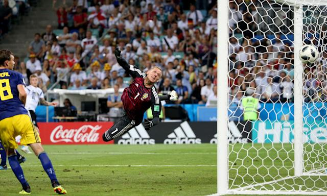 Germany's Toni Kroos watches from the edge of the area as his inch-perfect free-kick finds its way past Robin Olsen in the Sweden goal.