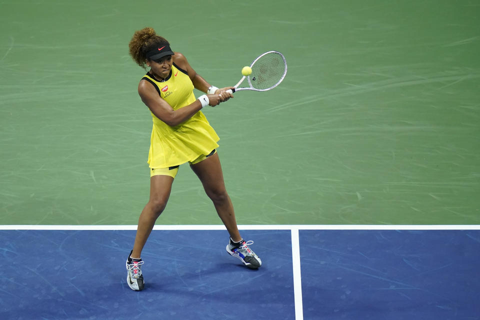 Naomi Osaka, of Japan, returns a shot to Marie Bouzkova, of the Czech Republic, during the first round of the US Open tennis championships, Monday, Aug. 30, 2021, in New York. (AP Photo/Frank Franklin II)
