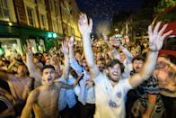 <p>Fans packed into bars, streets and outdoor cinemas to watch the game on Tuesday night. (Picture: Getty) </p>