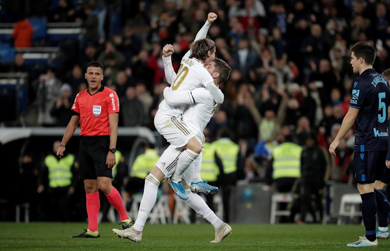 MADRID, SPAIN - NOVEMBER 23 : Federico Valverde (2nd R) of Real Madrid celebrates with his teammate Luka Modric (2nd L) after scoring during the Spanish league (La Liga) football match between Real Madrid CF and Real Sociedad at the Santiago Bernabeu Stadium in Madrid, Spain on November 23, 2019. (Photo by Burak Akbulut/Anadolu Agency via Getty Images)