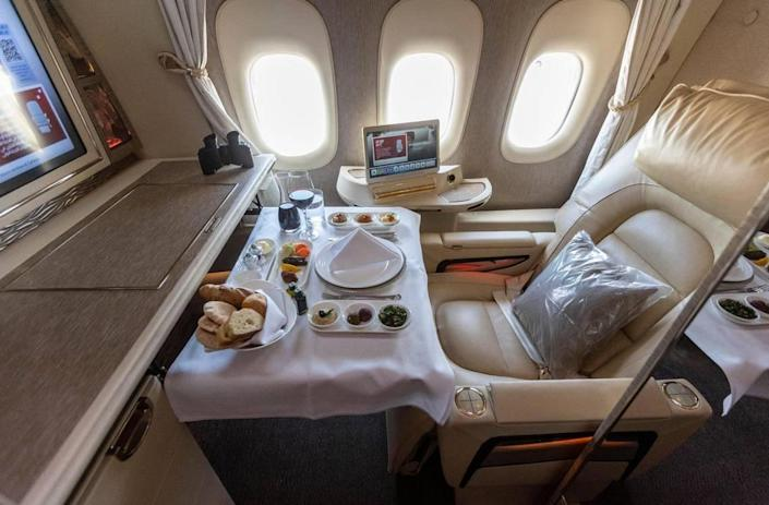 First class seating set up for dining, inside the Boeing 777-300ER operated by Emirates.