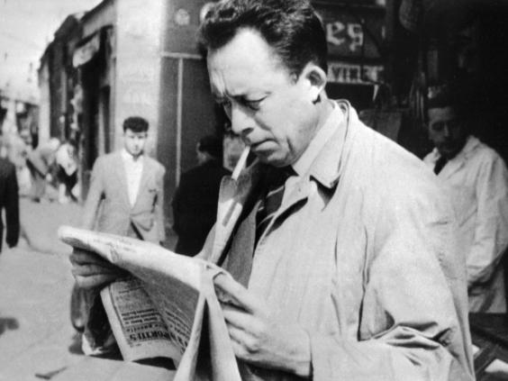 Reading a newspaper in Paris, 1959 (AFP/Getty)