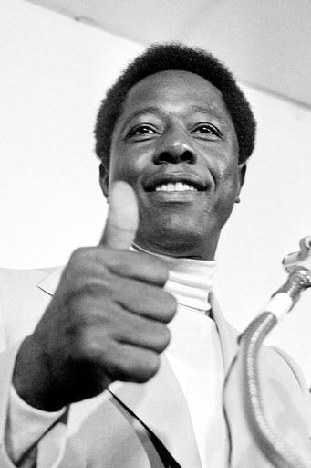 FILE - Atlanta Braves' Hank Aaron gives the thumbs-up sign to reporters indicating he will play in the season opener against the Cincinnati Reds at Riverfront Stadium in Cincinnati, in this April 4, 1974, file photo. Hank Aaron, who endured racist threats with stoic dignity during his pursuit of Babe Ruths home run record and gracefully left his mark as one of baseballs greatest all-around players, died Friday. He was 86. The Atlanta Braves, Aaron's longtime team, said he died peacefully in his sleep. No cause was given.(AP Photo/File)
