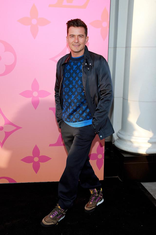 The actor chose a logo-emblazoned knit and Louis Vuitton trainers for the evening out. <em>[Photo: Getty]</em>