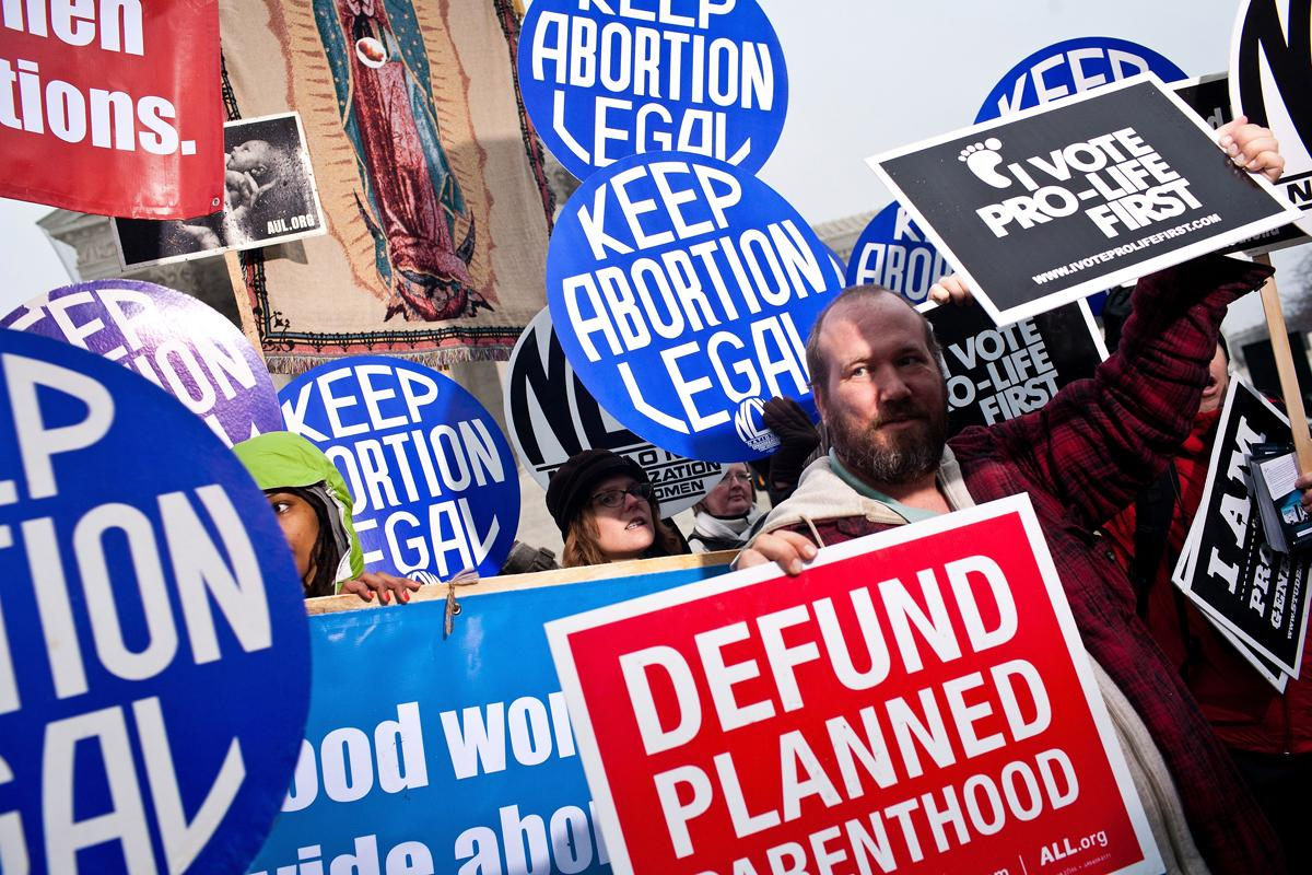A highly charged election year had political parties accusing one another of waging a war against women. Reproductive issues like abortion surfaced in the national discussion and in online searches. (Brendan Hoffman/Getty Images)
