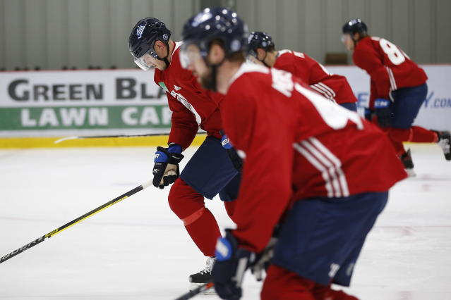 Winnipeg Jets' Dmitry Kulikov, left, skates during the first day of the NHL training camp in Winnipeg, Manitoba, Friday, Sept. 13, 2019. (John Woods/The Canadian Press via AP)