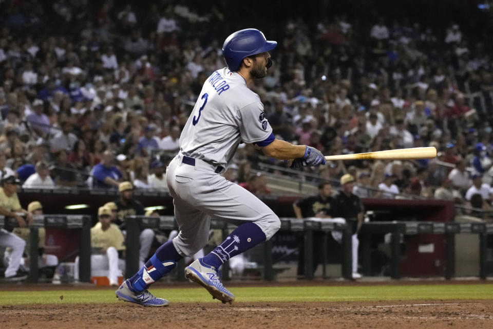 Los Angeles Dodgers' Chris Taylor watches his two-run triple against the Arizona Diamondbacks in the seventh inning during a baseball game, Friday, July 30, 2021, in Phoenix. (AP Photo/Rick Scuteri)