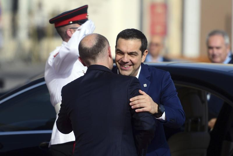 Greece Prime Minister Alexis Tsipras, right, is welcomed by Malta Prime Minister Joseph Muscat on the occasion of the Mediterranean Summit of Southern EU countries in Valetta, Malta, Friday, June 14, 2019. (AP Photo/Jonathan Borg)