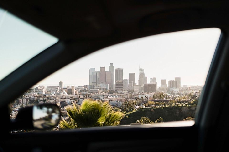 View of sunny cityscape out car window, Los Angeles, California