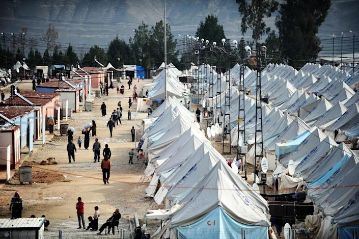 A picture taken on January 16, 2014 shows Syrian refugees walking among tents at Karkamis' refugee camp near the town of Gaziantep, south of Turkey (AFP Photo/Ozan Kose )