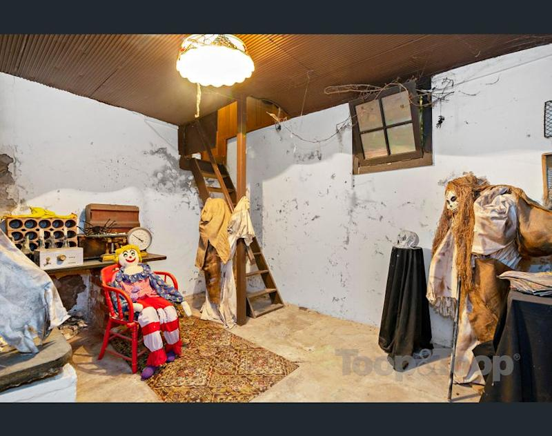 Odd dolls and decorations in the cellar of the Adelaide house for sale. (Image: realestate.com.au/Toop & Toop)