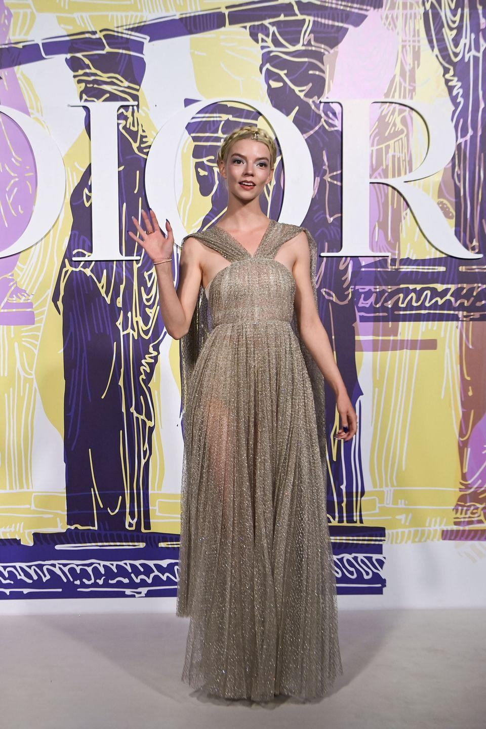 <p>The actor attended the Dior Cruise 2022 show in Athens wearing a shimmering gold Grecian-style gown by Dior.</p>